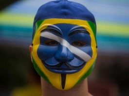 A protester of Brazil's corruption scandal