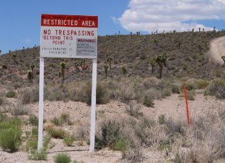 Area 51 no trespassing sign in the desert